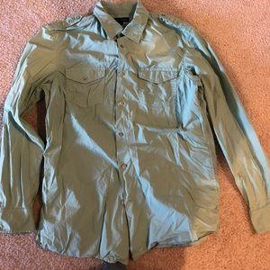 Green causal button down shirt.
